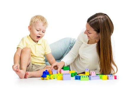 Mom and toddler playing blocks